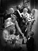 black and white informal reportage wedding photograph group